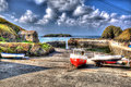Fishing boats Mullion Cove harbour Cornwall UK in colourful bright HDR Royalty Free Stock Photo