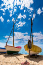Fishing boats in the sand of a beach two stranded Stock Photo