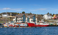Fishing boats stand moored in norway red and white village Royalty Free Stock Photography