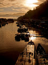 Fishing boats at sunrise docked in the river padang in west sumatra indonesia Royalty Free Stock Photography