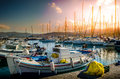 Fishing boats tied to dock port in at sunset Royalty Free Stock Photography