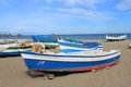 Fishing boats in torremolinos spain the sandy beach of costa del sol andalusia late afternoon Royalty Free Stock Image