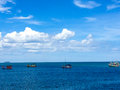 Fishing boats in tropical waters and blue sky with white clouds thailand Stock Photos