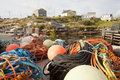 Fishing bouys and nets by villiage Royalty Free Stock Photo