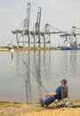 Fishing by the container port Stock Photo
