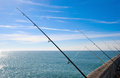 Fishing on deep ocean under blue sky Royalty Free Stock Photo