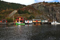 Fishing docks cabins boats on quidi vidi lake harbor newfoundland fisherman and piers in fall october canada Stock Photo