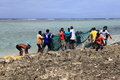 Fishing done and grasp a lot of fish the mauritius fishmen are in indian ocean in the morning coastal they usually do it during Stock Image