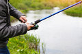 Fishing with a fishing rod on the river Royalty Free Stock Photo
