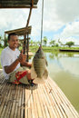 Fishing fishpond Stock Photos