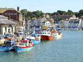 Fishing fleet weymouth dorset the moored by the quayside on the river wye at england uk Royalty Free Stock Images