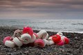 Fishing floats on the beach red and white pile of Stock Photography