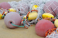 Fishing floats and fishing net nets on clean sandy beach sand Stock Photo