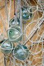 Fishing floats vintage glass with nets against a woven background Stock Photos