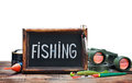 Fishing gear and blackboard isolated on white background Stock Images
