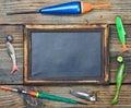 Fishing gear and blackboard Royalty Free Stock Photo