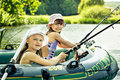 Fishing girls Royalty Free Stock Photos