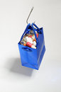 Fishing hook holding a blue bag with medicines full of pills hanging from as if it were bait Stock Image