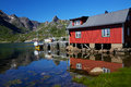 Fishing hut reflecting in fjord Royalty Free Stock Images