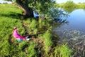 Fishing littlle girl on pond Royalty Free Stock Photo