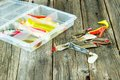 Fishing lures on the wood Stock Photo