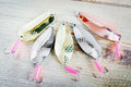 Fishing lures on wooden surface Royalty Free Stock Photo
