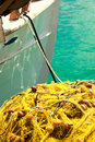 Fishing net and boat Stock Images