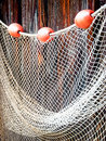 Fishing net at an old port Stock Photos