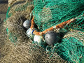 Fishing net on the pier in the sun Stock Photos