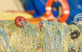 Fishing nets closeup with orange, yellow, blue colours. Royalty Free Stock Photo