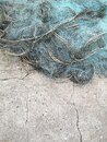 Fishing nets drying in the sun.Trawl of fisherman or net on the shore at fisherman village before storm. Royalty Free Stock Photo