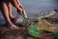 Fishing by nets beside lake Stock Photo