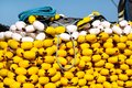 Fishing nets with yellow floats on the pile, close up Royalty Free Stock Photo