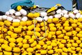 Fishing nets with yellow floats on the pile, close up