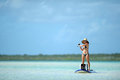 Fishing and paddleboarding in tropical destination Stock Photos