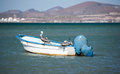 Fishing pelicans resting on a boat anchored off shore in la paz mexico Stock Photography