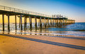 Fishing pier and the Atlantic Ocean at sunrise in Ventnor City, Royalty Free Stock Photo