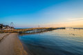 Fishing pier and the Chesapeake Bay at sunrise, in North Beach, Royalty Free Stock Photo