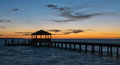Fishing pier and dock at sunset Royalty Free Stock Photo