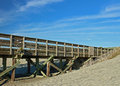 Fishing pier meets sand dune Royalty Free Stock Photo