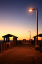 Fishing pier at sunrise desolate in florida dawn Stock Photos