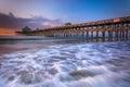 The fishing pier at sunrise, in Folly Beach, South Carolina. Royalty Free Stock Photo