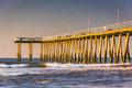Fishing pier and waves on the atlantic ocean at sunrise in ventn ventnor city new jersey Stock Photos