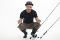Fishing is always pleasure happy fisherman sitting in great black waders showing us the size of fish he caught isolated on white Stock Image