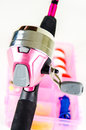 Fishing pole and tackle in pink gear box with awareness of breast cancer Stock Images