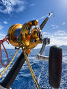 Fishing reel and pole in boat during big game Stock Photos