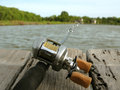 Fishing Reel with water Royalty Free Stock Photo