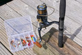 Fishing reels and lures reel close up Royalty Free Stock Image