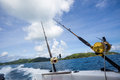Fishing rod on boat at sea Royalty Free Stock Photo