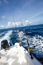 Fishing rod on boat at sea and reel side of with blue in background Stock Photography